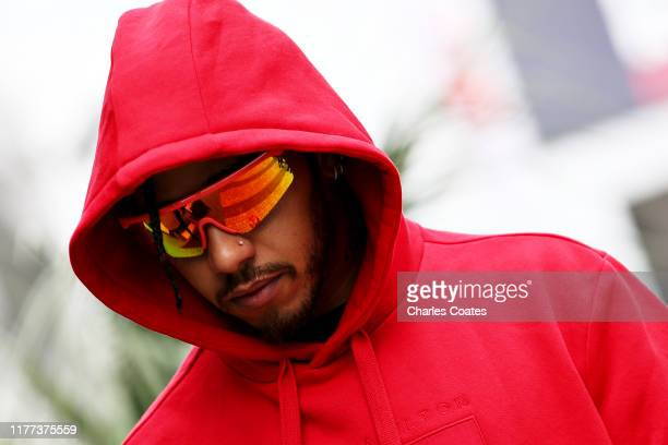 Lewis Hamilton of Great Britain and Mercedes GP walks in the Paddock before practice for the F1 Grand Prix of Russia at Sochi Autodrom on September...