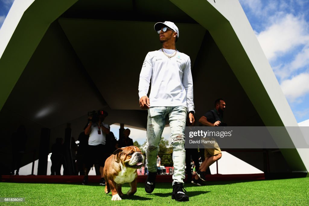 Lewis Hamilton of Great Britain and Mercedes GP walks in the Paddock with one of his dogs during previews for the Spanish Formula One Grand Prix at Circuit de Catalunya on May 11, 2017 in Montmelo, Spain.