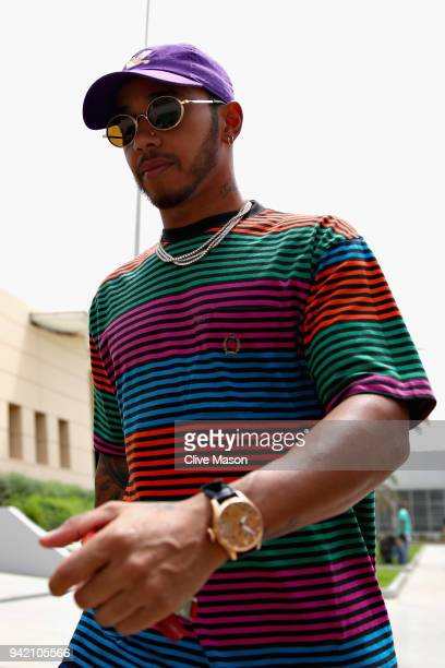 Lewis Hamilton of Great Britain and Mercedes GP walks in the Paddock during previews ahead of the Bahrain Formula One Grand Prix at Bahrain...