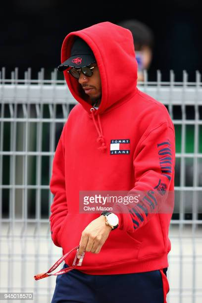 Lewis Hamilton of Great Britain and Mercedes GP walks in the Paddock during previews ahead of the Formula One Grand Prix of China at Shanghai...