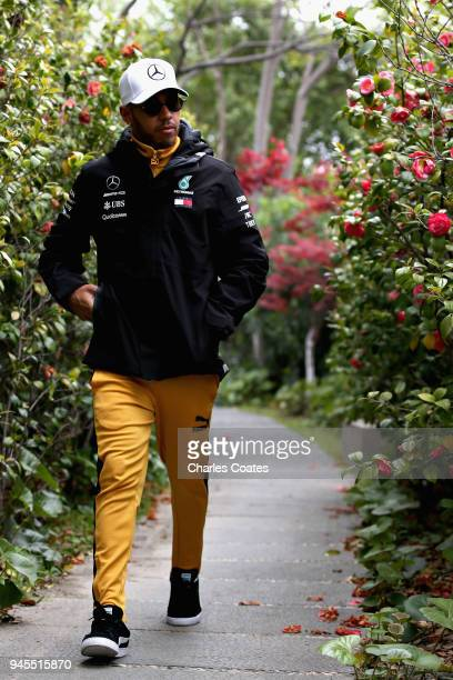 Lewis Hamilton of Great Britain and Mercedes GP walks in the Paddock before practice for the Formula One Grand Prix of China at Shanghai...