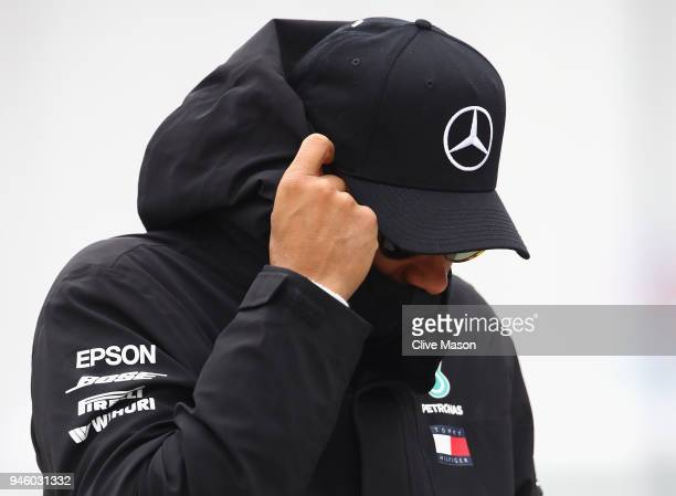 Lewis Hamilton of Great Britain and Mercedes GP walks in the Paddock before final practice for the Formula One Grand Prix of China at Shanghai...