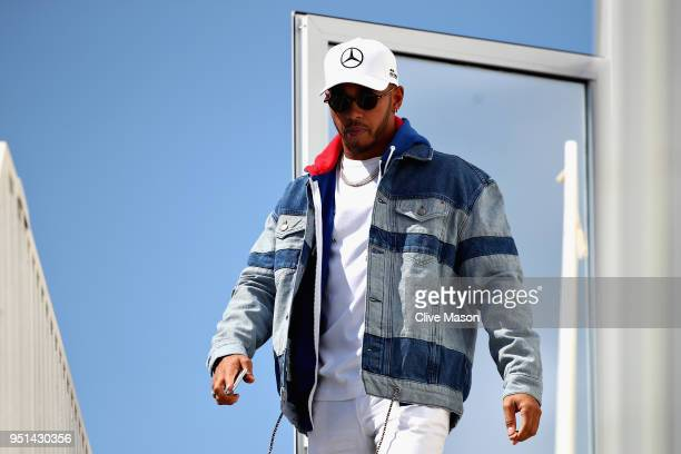 Lewis Hamilton of Great Britain and Mercedes GP walks in the Paddock during previews ahead of the Azerbaijan Formula One Grand Prix at Baku City...