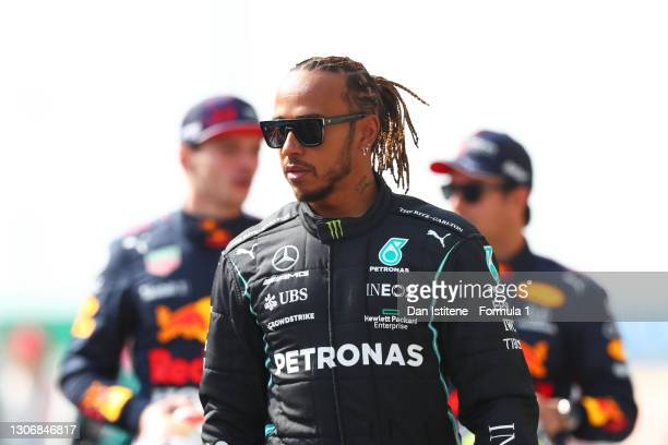 Lewis Hamilton of Great Britain and Mercedes GP walks on the grid during Day One of F1 Testing at Bahrain International Circuit on March 12, 2021 in...