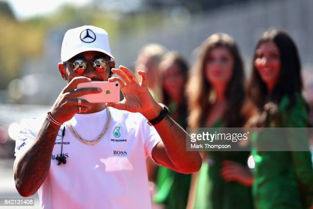 Lewis Hamilton of Great Britain and Mercedes GP walks to the drivers parade before the Formula One Grand Prix of Italy at Autodromo di Monza on...