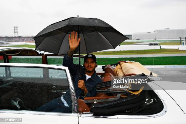 Lewis Hamilton of Great Britain and Mercedes GP waves to the crowd on the drivers parade before the F1 Grand Prix of Germany at Hockenheimring on...