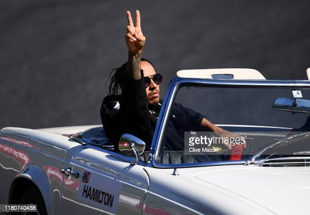 Lewis Hamilton of Great Britain and Mercedes GP waves to the crowd on the drivers parade before the F1 Grand Prix of Japan at Suzuka Circuit on...