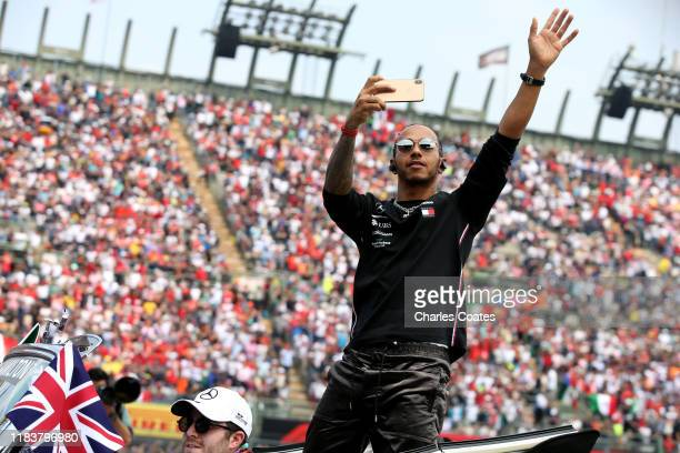Lewis Hamilton of Great Britain and Mercedes GP waves to the crowd on the drivers parade before the F1 Grand Prix of Mexico at Autodromo Hermanos...