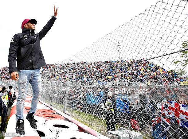 Lewis Hamilton of Great Britain and Mercedes GP waves to the crowd on the drivers parade during the Canadian Formula One Grand Prix at Circuit Gilles...