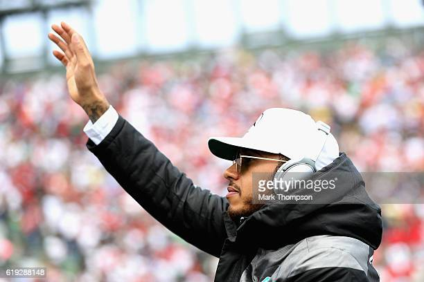 Lewis Hamilton of Great Britain and Mercedes GP waves to the crowd on the drivers parade before the Formula One Grand Prix of Mexico at Autodromo...