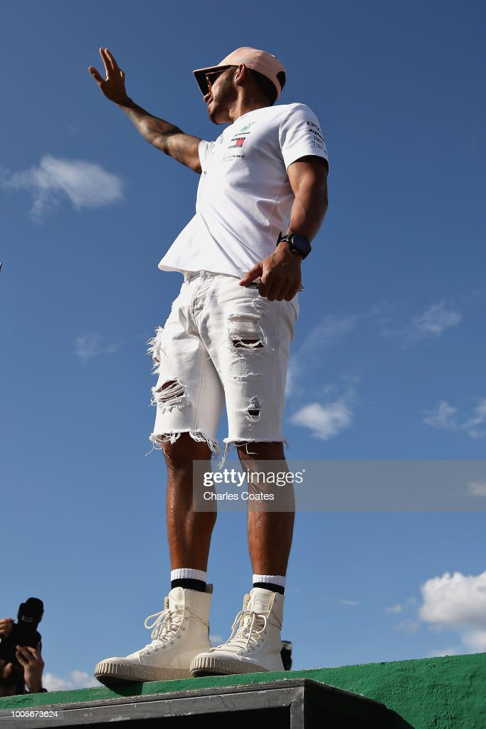 Lewis Hamilton of Great Britain and Mercedes GP waves to the crowd during previews ahead of the Formula One Grand Prix of Hungary at Hungaroring on July 26, 2018 in Budapest, Hungary.