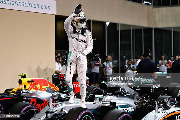 Lewis Hamilton of Great Britain and Mercedes GP waves to the crowd after qualifying on pole position during qualifying for the Abu Dhabi Formula One...