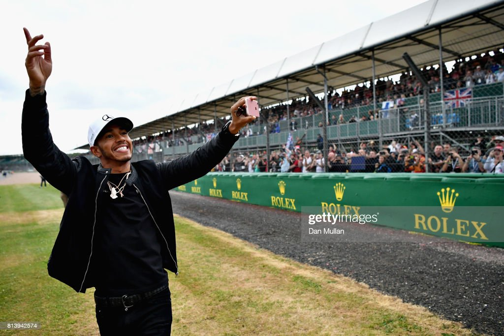 Lewis Hamilton of Great Britain and Mercedes GP waves to the crowd during previews ahead of the Formula One Grand Prix of Great Britain at Silverstone on July 13, 2017 in Northampton, England.