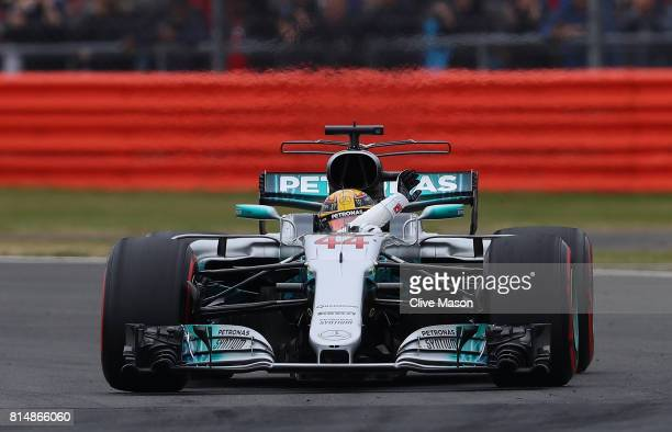 Lewis Hamilton of Great Britain and Mercedes GP waves to the crowd after qualifying in pole position during qualifying for the Formula One Grand Prix...