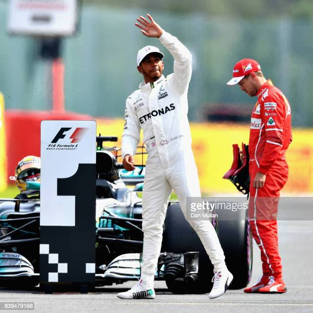 Lewis Hamilton of Great Britain and Mercedes GP waves to the crowd after qualifying on pole position during qualifying for the Formula One Grand Prix...