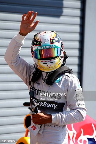 Lewis Hamilton of Great Britain and Mercedes GP waves to the fans after qualifying in pole position during Qualifying ahead of the F1 Grand Prix of...