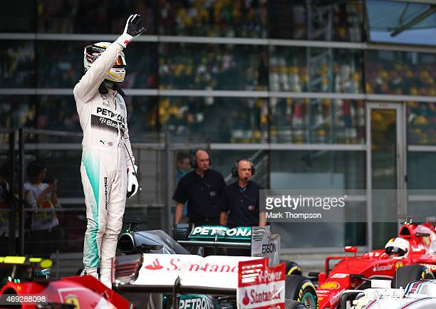 Lewis Hamilton of Great Britain and Mercedes GP waves to the fans after securing pole position during qualifying for the Formula One Grand Prix of...