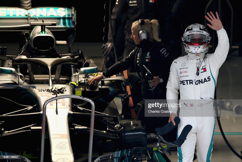 Lewis Hamilton of Great Britain and Mercedes GP waves to the fans from his garage during qualifying for the Formula One Grand Prix of China at Shanghai International Circuit on April 14, 2018 in Shanghai, China.