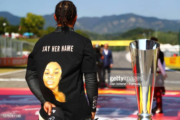 Lewis Hamilton of Great Britain and Mercedes GP wears a t-shirt displaying the message 'say her name' above a photo of Breonna Taylor after taking a...