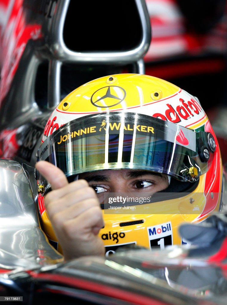 Lewis Hamilton of Great Britain and team McLaren Mercedes gives a thumbs up to his mechanics during Formula one testing at the Ricardo Tormo racetrack on January 23, 2008, in Cheste near Valencia, Spain.