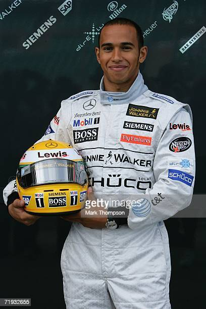 Lewis Hamilton of Great Britain before driving a McClaren MP421 for the first time during Formula one testing at Silverstone Circuit on September 19...