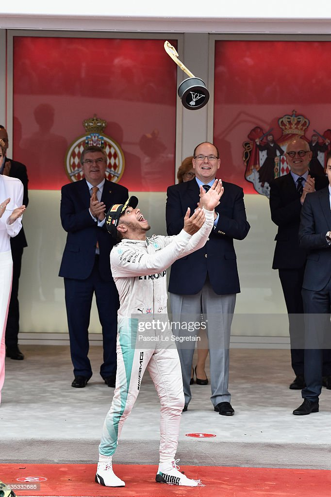 Lewis Hamilton of Great Britain celebrates on the podium after winning the F1 Grand Prix of Monaco May 29, 2016 in Monte-Carlo, Monaco.
