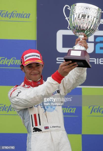 Lewis Hamilton of Great Britain celebrates on the podium after finishing second during the GP2 race at the Circuit De Catalunya on May 13 in...
