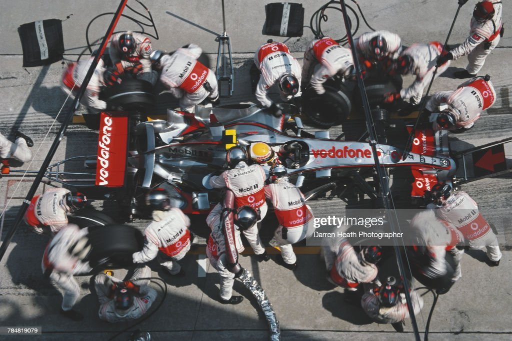 Lewis Hamilton of Great Britain driver of the #2 Vodafone McLaren MercedesMcLaren MP4-22 Mercedes V8 is surrounded by mechanics as he makes a pit stop for new tyres and fuel during the Formula One Petronas Malaysian Grand Prix on 8 April 2007 at the Sepang International Circuit in Kuala Lumpur, Malaysia.