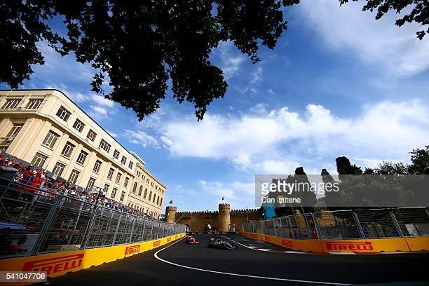 Lewis Hamilton of Great Britain drives the 4 Mercedes AMG Petronas F1 Team Mercedes F1 WO7 Mercedes PU106C Hybrid turbo ahead of Sebastian Vettel of...