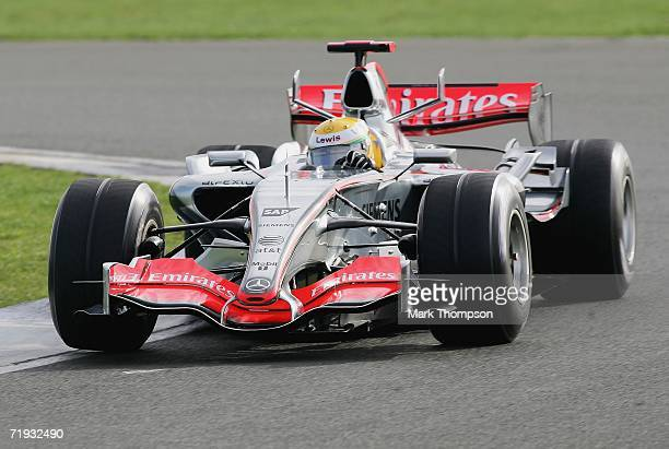 Lewis Hamilton of Great Britain drives the McClaren MP421 car for the first time during Formula one testing at Silverstone Circuit on September 19...