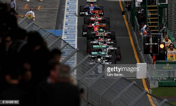 Lewis Hamilton of Great Britain drives the Mercedes AMG Petronas F1 Team Mercedes F1 WO7 Mercedes PU106C Hybrid turbo ahead of the rest of the grid...