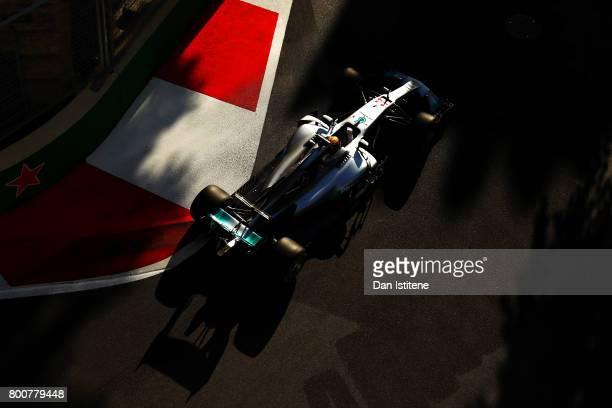 Lewis Hamilton of Great Britain drives the Mercedes AMG Petronas F1 Team Mercedes F1 WO8 during the Azerbaijan Formula One Grand Prix at Baku City...