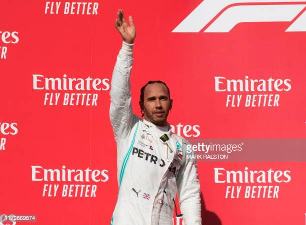 TOPSHOT Lewis Hamilton of Great Britain driving for the Mercedes AMG Petronas F1 Team reacts after being crowned World Champion during his second...