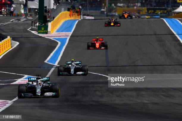 Lewis Hamilton of Great Britain driving the and Valtteri Bottas of Finland driving the Mercedes-AMG Petronas Motorsport W10, Charles Leclerc of...