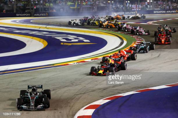 Lewis Hamilton of Great Britain driving the Mercedes AMG Petronas F1 Team Mercedes WO9 and the rest of the field at the start during the Formula One...
