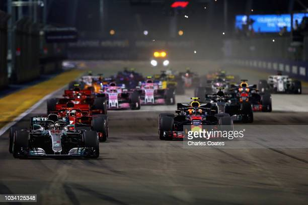 Lewis Hamilton of Great Britain driving the Mercedes AMG Petronas F1 Team Mercedes WO9 leads Max Verstappen of the Netherlands driving the Aston...