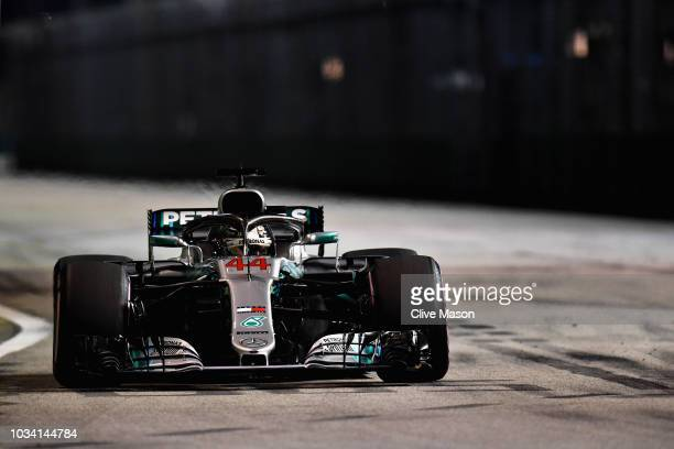 Lewis Hamilton of Great Britain driving the Mercedes AMG Petronas F1 Team Mercedes WO9 on track during the Formula One Grand Prix of Singapore at...
