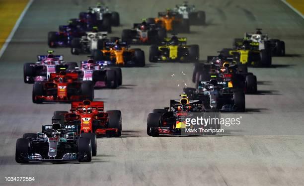 Lewis Hamilton of Great Britain driving the Mercedes AMG Petronas F1 Team Mercedes WO9 leads Sebastian Vettel of Germany driving the Scuderia Ferrari...