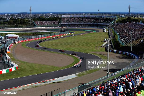 Lewis Hamilton of Great Britain driving the Mercedes AMG Petronas F1 Team Mercedes WO9 leads the field during the Formula One Grand Prix of Japan at...