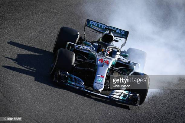 Lewis Hamilton of Great Britain driving the Mercedes AMG Petronas F1 Team Mercedes WO9 locks a wheel under braking during the Formula One Grand Prix...