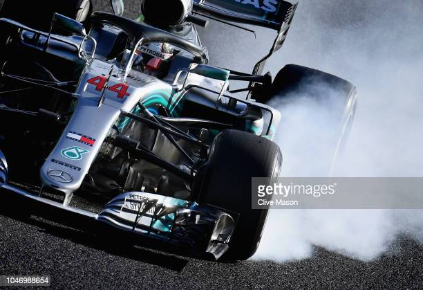 Lewis Hamilton of Great Britain driving the Mercedes AMG Petronas F1 Team Mercedes WO9 locks a wheel under braking during the Formula One Grand Prix...