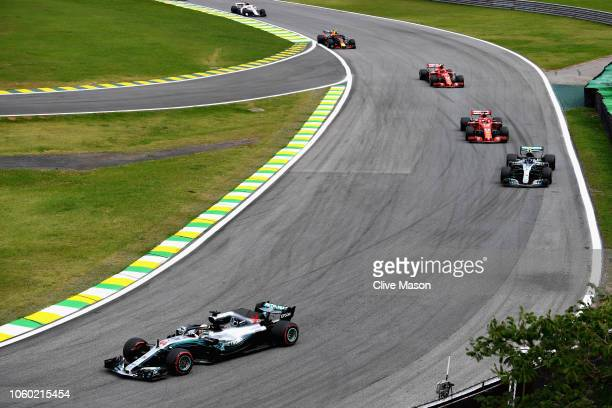 Lewis Hamilton of Great Britain driving the Mercedes AMG Petronas F1 Team Mercedes WO9 leads Valtteri Bottas driving the Mercedes AMG Petronas F1...