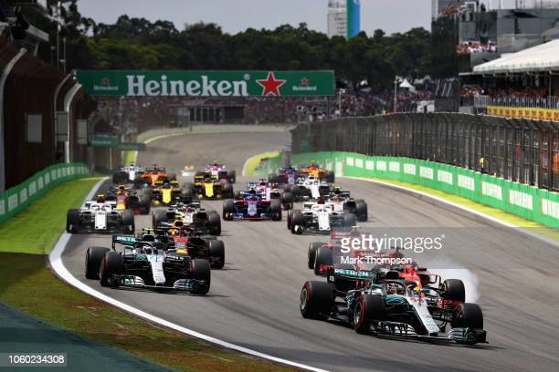 Lewis Hamilton of Great Britain driving the Mercedes AMG Petronas F1 Team Mercedes WO9 leads the field at the start as Sebastian Vettel of Germany...
