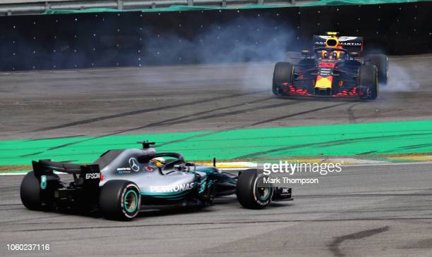 Lewis Hamilton of Great Britain driving the Mercedes AMG Petronas F1 Team Mercedes WO9 passes as Max Verstappen of the Netherlands driving the Aston...