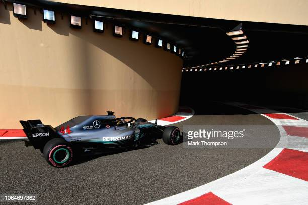 Lewis Hamilton of Great Britain driving the Mercedes AMG Petronas F1 Team Mercedes WO9 leaves the pitlane during final practice for the Abu Dhabi...