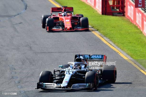 Lewis Hamilton of Great Britain driving the Mercedes AMG Petronas F1 Team Mercedes W10 leads Sebastian Vettel of Germany driving the Scuderia Ferrari...