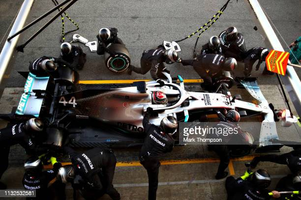 Lewis Hamilton of Great Britain driving the Mercedes AMG Petronas F1 Team Mercedes W10 makes a pit stop for new tyres during day two of F1 Winter...