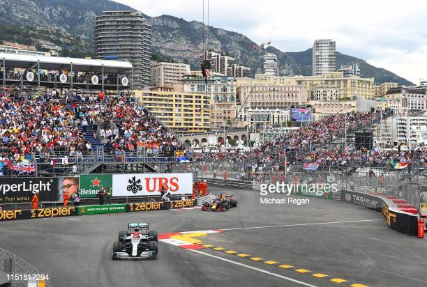 Lewis Hamilton of Great Britain driving the Mercedes AMG Petronas F1 Team Mercedes W10 leads Max Verstappen of the Netherlands driving the Aston...