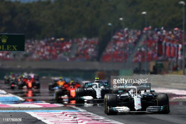 Lewis Hamilton of Great Britain driving the Mercedes AMG Petronas F1 Team Mercedes W10 leads the field on the first lap during the F1 Grand Prix of...