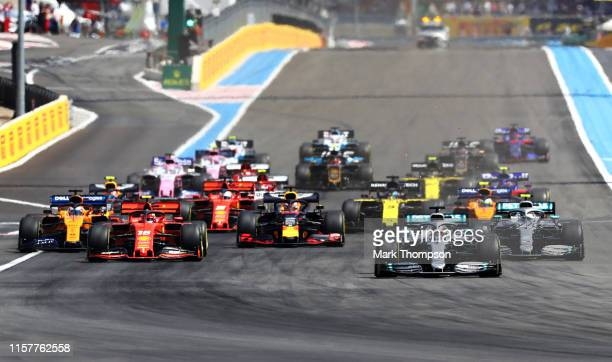 Lewis Hamilton of Great Britain driving the Mercedes AMG Petronas F1 Team Mercedes W10 leads the field into turn one at the start during the F1 Grand...